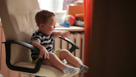 Two Year Old Boy Is Spinning On Chair stock footage