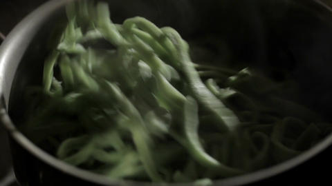 Cooking pasta. Beautiful back light macro shot with steam Footage