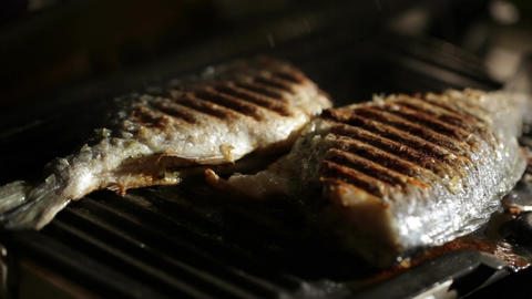 Opening the grill and checking fish Stock Video Footage