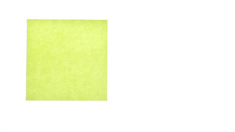 Man's hand put blank yellow sticker isolated on a white... Stock Video Footage