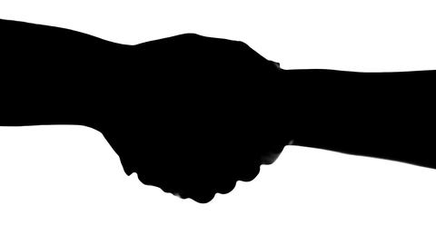 Shaking hands of two people, silhouette isolated on white Stock Video Footage