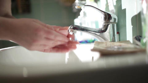 Washing hands with soap in the bathroom. Close up Footage