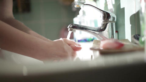 Washing hands with soap in the bathroom. Close up Stock Video Footage