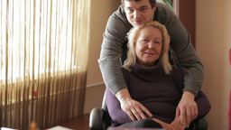 Thirty-year-old son hugs his mother looking to the camera Stock Video Footage