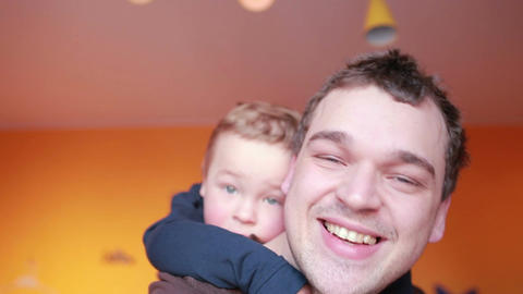 Close up portraits of happy father and his son Footage