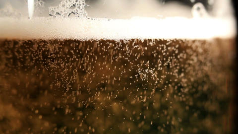 Pouring beer. Macro shot Footage