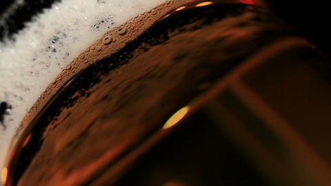 Pouring beer. Macro shot. Low angle Stock Video Footage