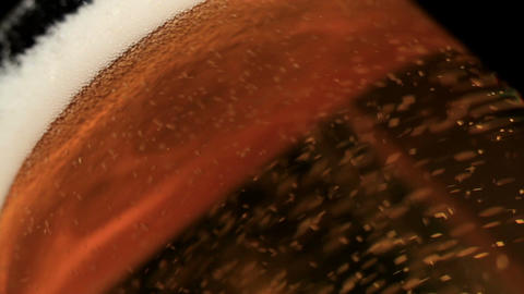 Pouring beer. Macro shot. Low angle Footage