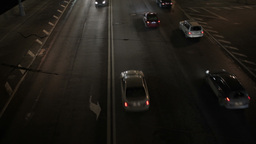 Car traffic at night. High angle shot. Real time Stock Video Footage