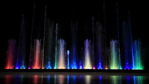 Dancing beautiful colorful fountain with reflection in... Stock Video Footage