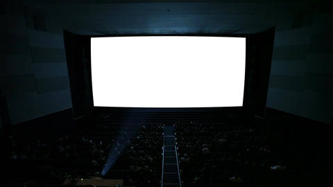 White cinema screen with projector light and audience in... Stock Video Footage