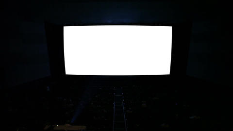 White Cinema Screen With Projector Light And Audience In A Modern Cinema House.  stock footage