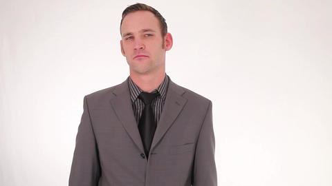 Thoughtful young businessman dismisses Stock Video Footage