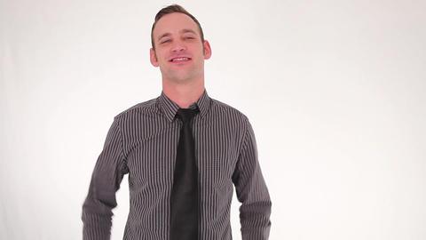 Businessman ties up his tie Stock Video Footage