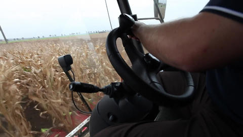 Farmer driving a thresher Stock Video Footage