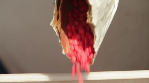 Pouring out red corn seeds Stock Video Footage