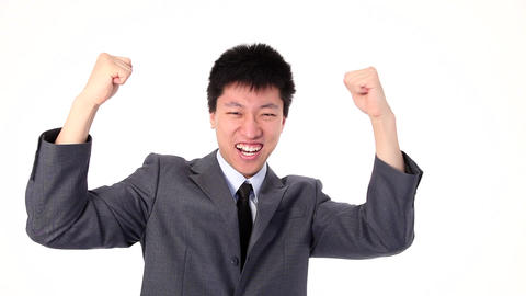 Happy young Asian businessman screaming for joy Stock Video Footage