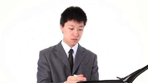 Young Asian businessman writing something Stock Video Footage