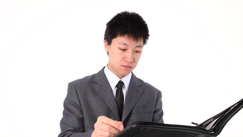 Young Asian businessman writing something Footage
