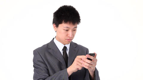 Asian young businessman using a smart phone Footage