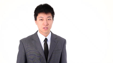 Asian young businessman talking ernestly on a smart phone Stock Video Footage