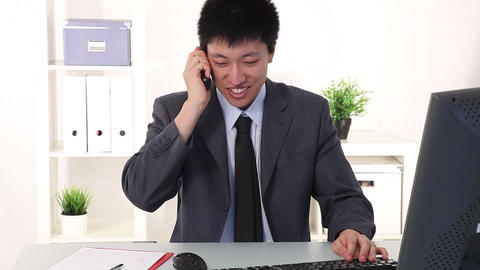 Happy young Asian businessman screaming for joy Footage