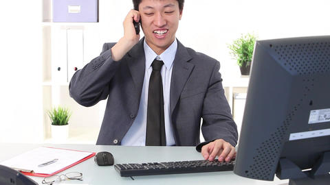 Young Asian businessman working at his desk Footage