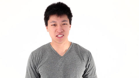 Young asian man showning two thumbs up Stock Video Footage