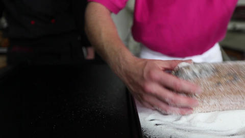 Baker pouring sugar on Poppy-Seed-Stollen Stock Video Footage