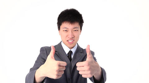 Asian young man showing thumbs up, portrait Stock Video Footage