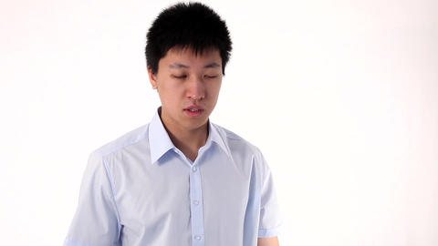Young Asian man talking on smartphone Stock Video Footage
