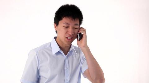 Young Asian Man Talking On Smartphone stock footage