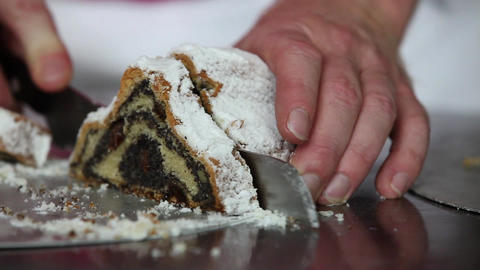 Baker cutting delicious Poppy-Seed-Stollen Stock Video Footage