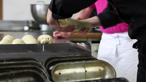 Putting Poppy-Seed- Stollen in baking tin Stock Video Footage