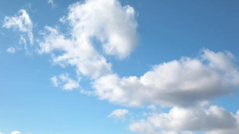 Time lapse clip of white fluffy clouds over blue sky Footage