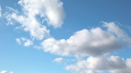 Time lapse clip of white fluffy clouds over blue sky Stock Video Footage