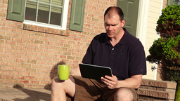 Man with iPad Outside Stock Video Footage
