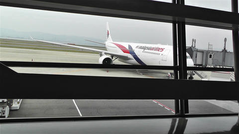 Looking Through Window Frames To Malaysia Airline Plane stock footage