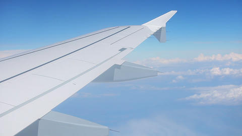Wing Of Airplane And Blue Sky With Clouds stock footage