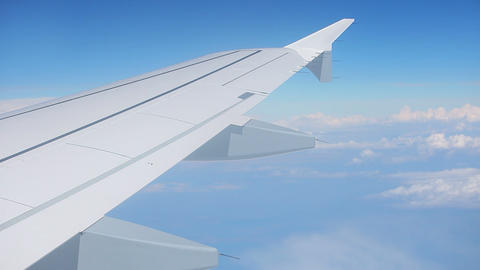 Wing of airplane and blue sky with clouds Stock Video Footage