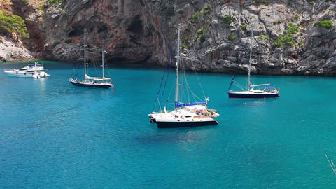 Yachts in beautiful bay with crystal clear water, Sa Calobra, Mallorca, Spain Footage