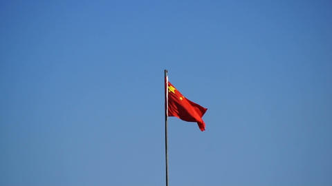Chinese red flag against blue sky Stock Video Footage