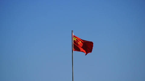 Chinese red flag against blue sky Footage