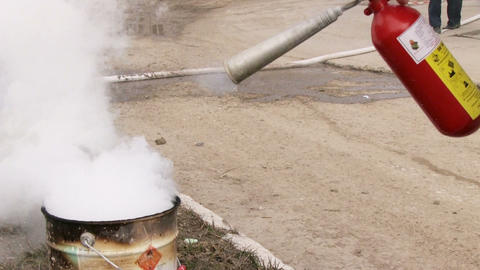 Man using fire extinguisher Stock Video Footage