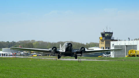 historic airplane Junkers JU 52 waiting on taxiway 10910 Footage