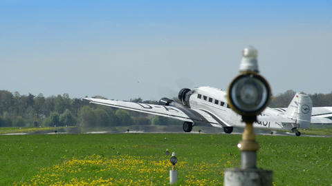 historic airplane Junkers JU 52 rolling start position 10912 Stock Video Footage