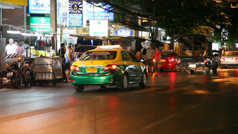 Tuk-Tuk on night street in Bangkok Stock Video Footage