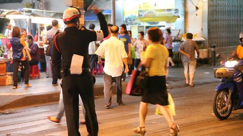 Policeman on night street in Bangkok Footage