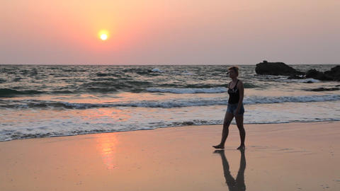 Young woman walk Ngapali beach during sunset, Myanmar Footage