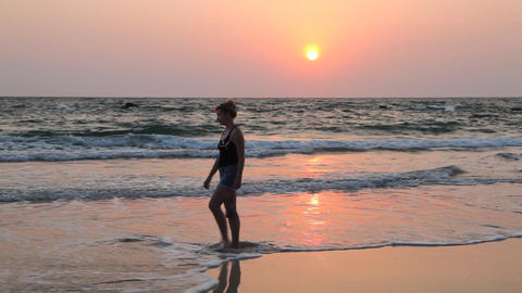 Young woman walk Ngapali beach during sunset, Myanmar Stock Video Footage